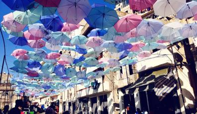 Colorful umbrellas hanging above a street